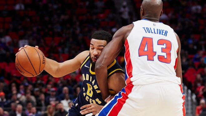 Indiana Pacers guard Cory Joseph (6) dribbles defended by Detroit Pistons forward Anthony Tolliver (43) in the first half at Little Caesars Arena.