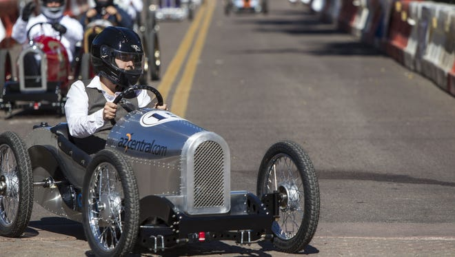 Drivers make a turn during the Grand Prix of Scottsdale in Old Town Scottsdale on Saturday, Nov. 7, 2015.