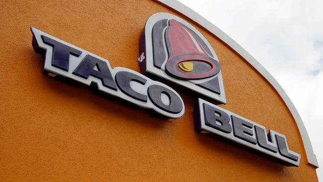 FILE - This Friday, May 23, 2014, file photo, shows the sign at a Taco Bell in Mount Lebanon, Pa. Taco Bell spokesman Rob Poetsch said Feb. 23, 2017, that theits Naked Chicken Chalupa, a sandwhich with a shell made out of fried chicken, will be pulled from menus as it was always intended to be a limited time offer.