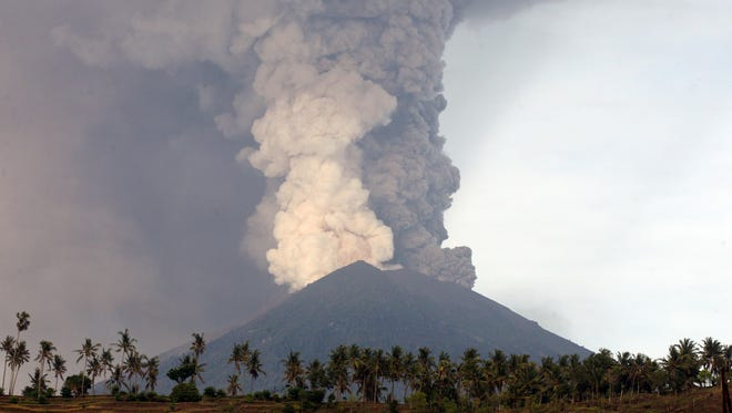 Mount Agung volcano spews smoke and ash in Karangasem, Bali, Indonesia on Nov. 27, 2017.