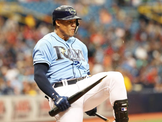 Tampa Bay Rays right fielder Carlos Gomez breaks his