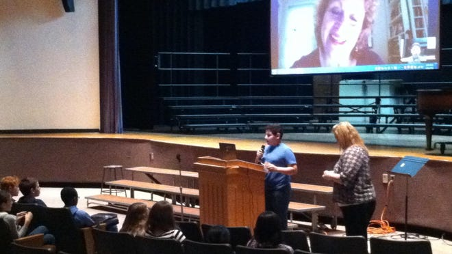 Hillside sixth-grader Faraaz Shaik asked author Haya Leah Molnar, up on the screen, a question via Skype.