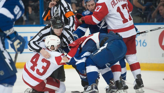 The Red Wings and the Lightning mix it up during a second period fight.