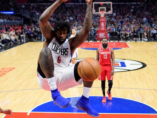 Los Angeles Clippers center DeAndre Jordan, left, dunks