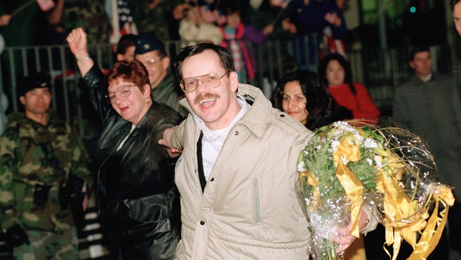 FILE - In this Dec. 5, 1991 file photo, AP chief Middle East correspondent Terry Anderson, accompanied by his sister Peggy Say, left, smiles at the Wiesbaden Air Force hospital in Germany, a day after being released by his abductors in Beirut (AP Photo/Thomas Kienzle, File)