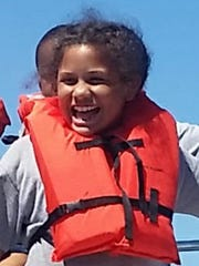 Dericka Lindsay, 9, smiles for the camera in this recent