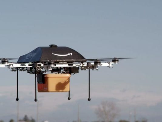 -Amazone Drone Delivery.JPEG-08a5d.jpg_20131202.jpg