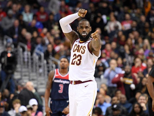 Cleveland Cavaliers forward LeBron James (23) gestures after scoring during the second half of an NBA basketball game as Washington Wizards guard Bradley Beal (3) looks on, Sunday, Dec. 17, 2017, in Washington. (AP Photo/Nick Wass)