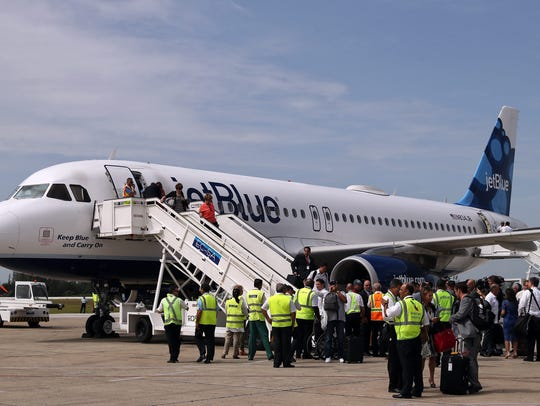 Passengers disembark from the U.S. airline JetBlue's
