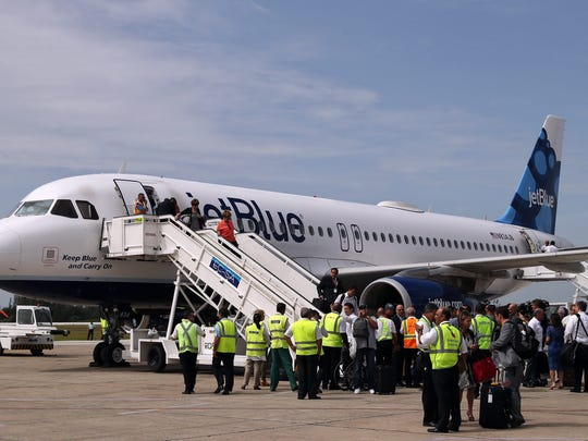 Passengers disembark from the U.S. airline JetBlue's Flight 387 at the Abel Santamaria airport in the city of Santa Clara, Cuba, on Aug. 31, 2016. This was the first commercial flight between the U.S. and Cuba since 1961, landed  after a trade embargo prohibited tourist air service between the two countries for over five decades.