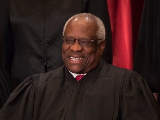 Associate Justice Clarence Thomas poses for a group photo on June 1, 2017 with all nine Supreme Court Justices in the East Conference Room of the Supreme Court Building.