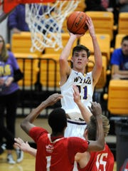 Wylie's Dylan Isenhower (21) shoots the ball during the first quarter of the Bulldogs' 59-51 win on Saturday, Dec. 17, 2016, at Wylie High School.