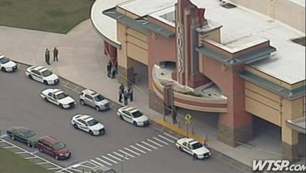 Emergency vehicles respond to a shooting at a Wesley Chapel, Fla., cinema that left two people injured. A suspected shooter has been taken into custody.