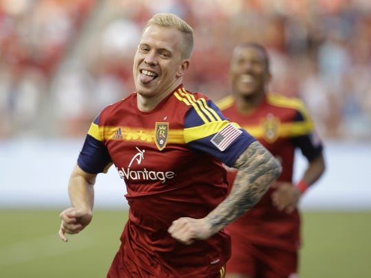 Real Salt Lake's Luke Mulholland celebrates after scoring a goal against the Montreal Impact during the first half of an MLS soccer game on Thursday, July 24, 2014, in Sandy, Utah. (AP Photo/Rick Bowmer)