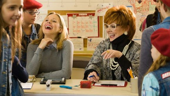 """Kristen Bell, left, and Melissa McCarthy in a scene from """"The Boss."""""""