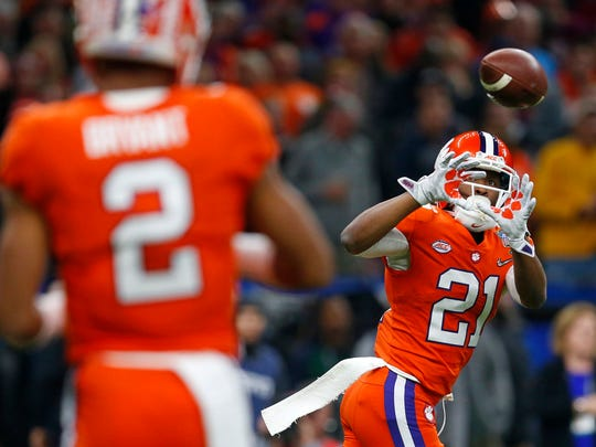 Clemson quarterback Kelly Bryant (2) passes to wide receiver Ray-Ray McCloud (21) in the first half of the Sugar Bowl semifinal playoff game against Alabama for the NCAA college football national championship, in New Orleans, Monday, Jan. 1, 2018. (AP Photo/Butch Dill)