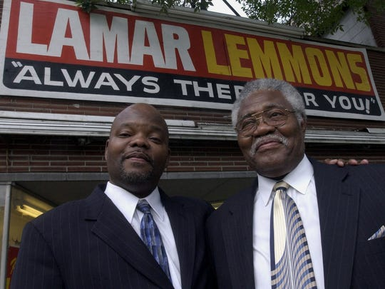 Former State Rep. LaMar Lemmons III, left, and his father former state Rep. LaMar Lemmons Jr., pose for this file photo on Aug. 4, 2004, in front of their headquarters in Detroit. The Lemmons name is known on the city's east side.