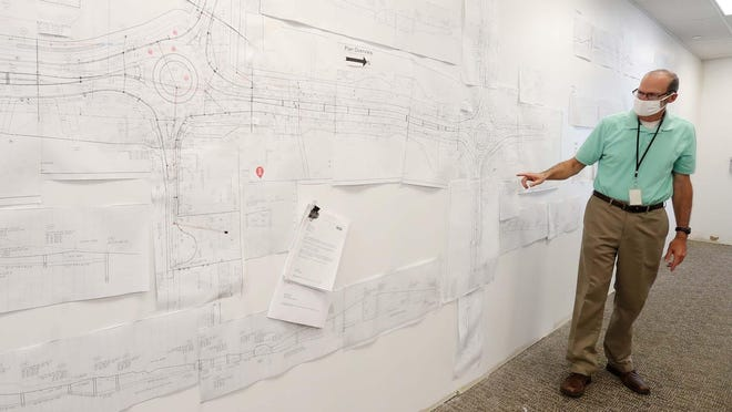 Paul Pickett, City of Green engineer, describes plans for the three new roundabouts on Massillon Road Tuesday, Aug. 18, 2020 in  Green, Ohio.