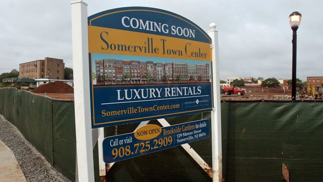 The developer of the Somerville Town Center on West Main Street is suing the borough about the project's delays and who is responsible for funding a parking deck.