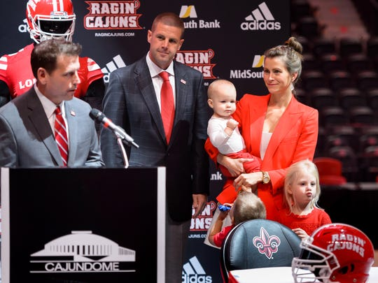 Billy Napier and some of his family, including wife Ali, is introduced last December as coach of the Ragin' Cajuns by UL athletic director Bryan Maggard.