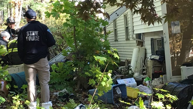 Investigators at the scene of the fatal fire in Southbridge early Thursday.