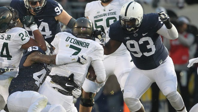 Penn State linebacker Manny Bowen makes a tackle against Michigan State earlier in his career. PSU head coach James Franklin has said that Bowen won't start for the Nittany Lions in the 2018 season opener. Bowen was recently reinstated to the Lions' program. FILE PHOTO