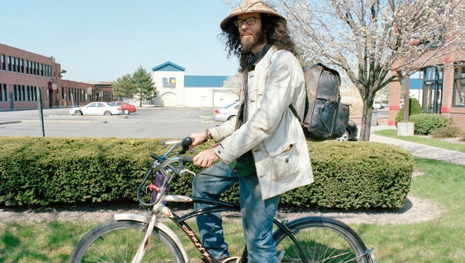 An image from Trevor Raab's project photographing Rochesterians on their bicycles.