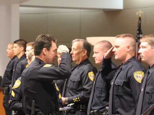 TPD Chief Michael DeLeo swearing in a new officer Monday morning.