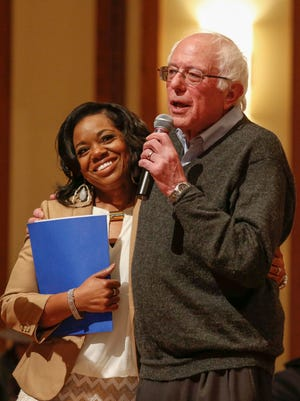 Democratic presidential candidate Bernie Sanders hugs Kishia Saffold of Dothan, Ala., after she told a personal story during a forum at First Christian Church on Jan. 9 in Des Moines.