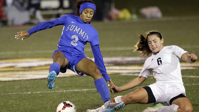Summit's  Ravin Alexander battles Grandview's Molly Smith for the ball.