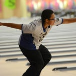 Anthony Castro of Heritage takes his turn during Wednesday's bowling at Shore Lanes Palm Bay.