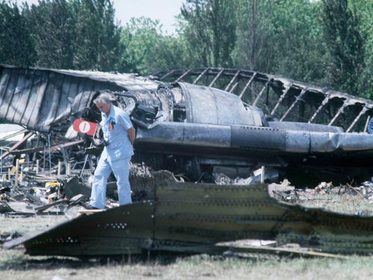 Investigators view the wreckage of American Airlines