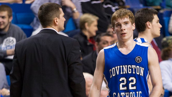 Covington Catholic head coach Scott Ruthsatz and his son, Nick Ruthsatz, take part in the state championship game.