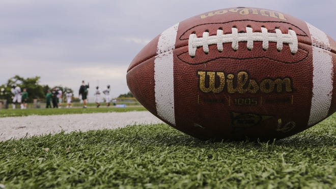 A football lays on the field at Lake Orion High School.