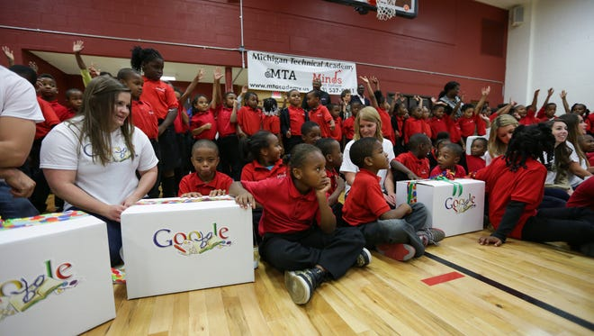 In this 2014 file photo, Michigan Technical Academy students pose for a photo with their teachers, former Detroit Piston  Earl Curleton and Michigan Google employees after an announcement that their teacher's requests for help with school supplies was granted by the DonorsChoose.org web site.