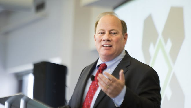 Detroit Mayor Mike Duggan speaks as  the long-awaited Blight Removal Task Force report is revealed outlying the city's plans at Focus Hope in Detroit, Tuesday, May 27,  2014.