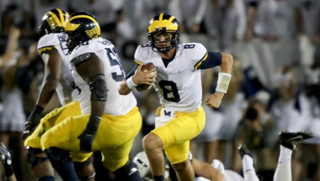 Michigan quarterback John O'Korn has one passing touchdown this season for the Wolverines.