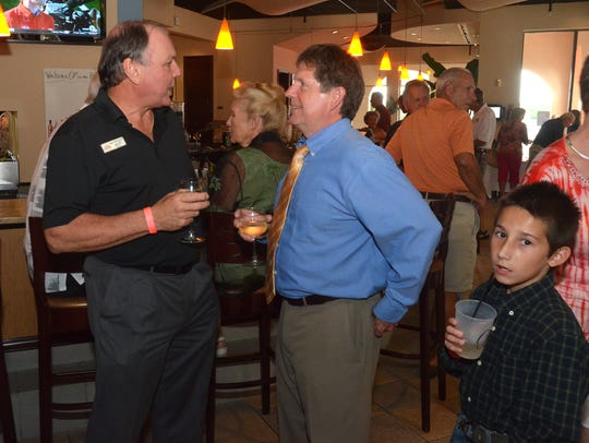 Stan Niemczyk talks with Bill Morris at a fundraiser.