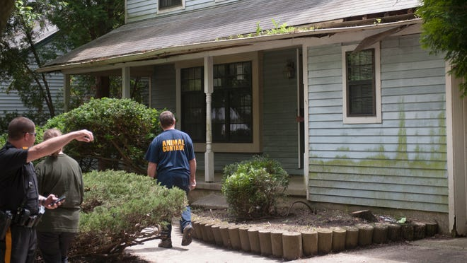 Officials descend on a vacant house located at 38 Yale Road in Evesham to investigate animal infestation and other possible health and safety issues.