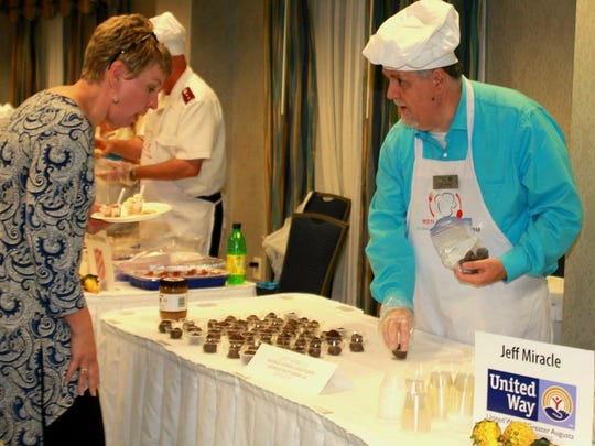 """Jeff Miracle, of United Way of Greater of Augusta, serves up his """"double dipped chocolate cookie butterballs"""" at the 2017 Men Who Cook event on Saturday, Oct. 21, 2017, in Waynesboro, Va."""
