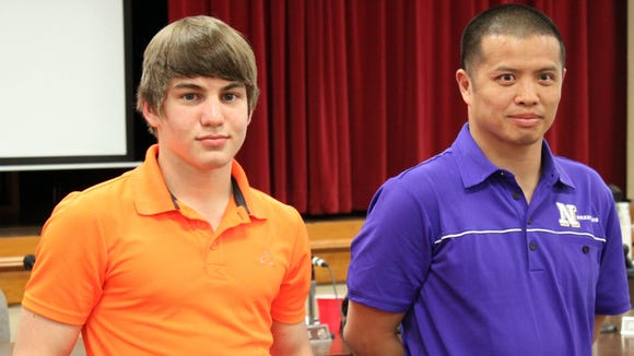 North Henderson junior Mitchel Langford, left, and Knights coach Heang Uy.