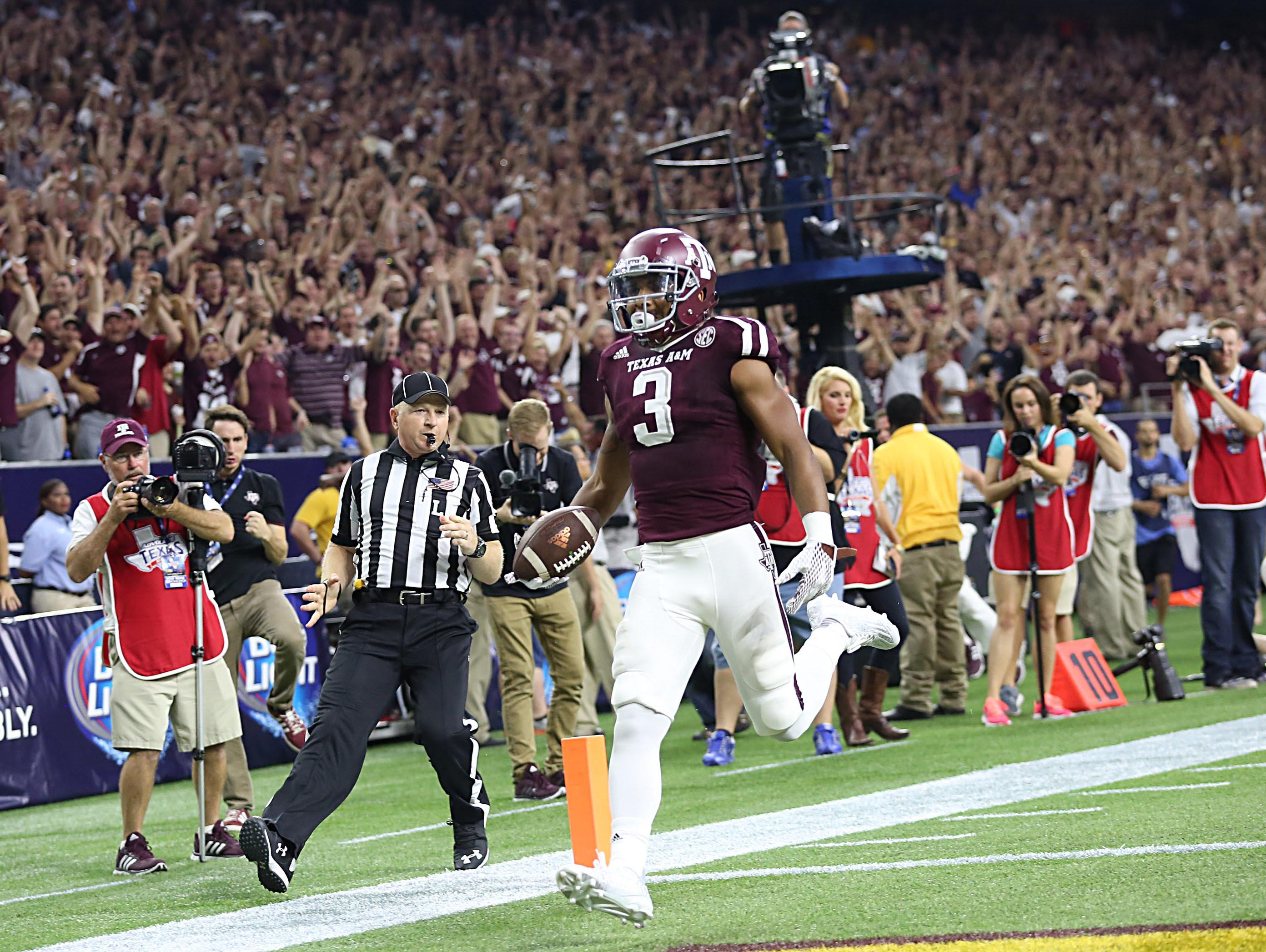 Texas A&M Aggies wide receiver Christian Kirk (3) returns a punt return for a 79 yard touchdown against the Arizona State Sun Devils in the second quarter at NRG Stadium. Kirk attended Scottsdale Saguaro High.