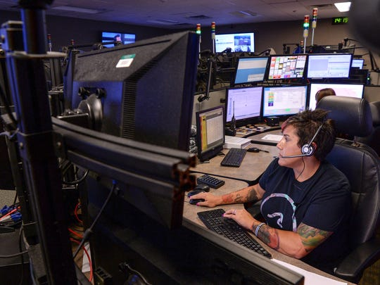 Marrell Harbin, right, dispatch supervisor of the Anderson County 911 Center in Anderson, takes a call on Tuesday.