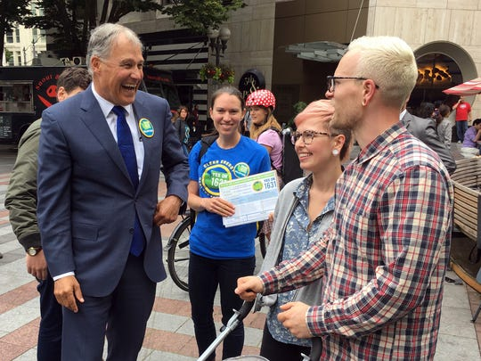 Gov. Jay Inslee helped gather signatures for a proposed initiative that would charge large industrial emitters a fee for their carbon emissions. Backers of Initiative 1631 say they will turn in about 365,000 signatures to qualify the carbon pollution fee measure for the November ballot.