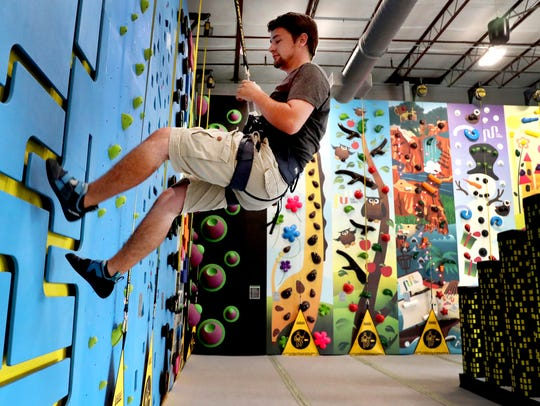 David Moss tries out the kids climbing area at Climb