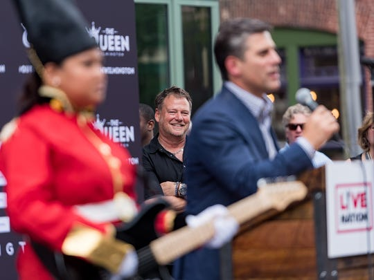 Michael Grozier, executive vice president of Live Nation's clubs and theaters, smiles at remarks made by Chris Buccini of the Buccini/Pollin Group at The Queen Wednesday.