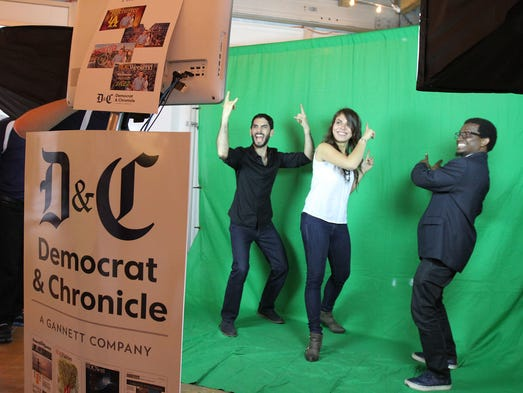 Pablo Menares, Melissa Aldana, and Francisco Mela of Melissa Aldana and Crash Trio pose in the photo booth located in the Democrat and Chronicle's Digital Jazz Club right on Jazz Street.