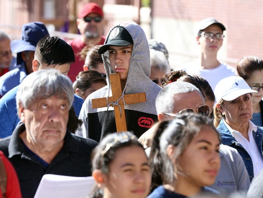 Rev. Trini Fuentez of St. Patrick Cathedral leads the annual Stations of the Cross around the cathedral in central El Paso. Prayers were directed mostly toward immigrants.