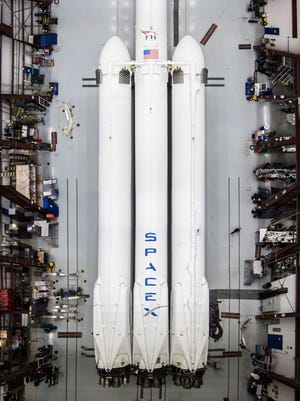 SpaceX's Falcon Heavy rocket is seen here at a Kennedy Space Center hangar. The three-core, 27-engine rocket is slated to launch from KSC in early 2018.
