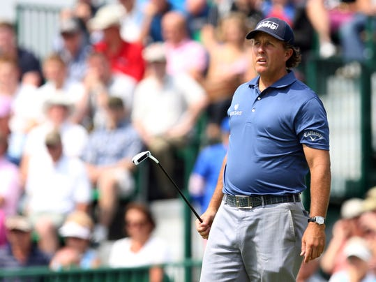 Phil Mickelson of the US watches his putt on the 12th green during the second day of the British Open Golf championship at the Royal Liverpool golf club, Hoylake, England, Friday July 18, 2014. (AP Photo/Scott Heppell)